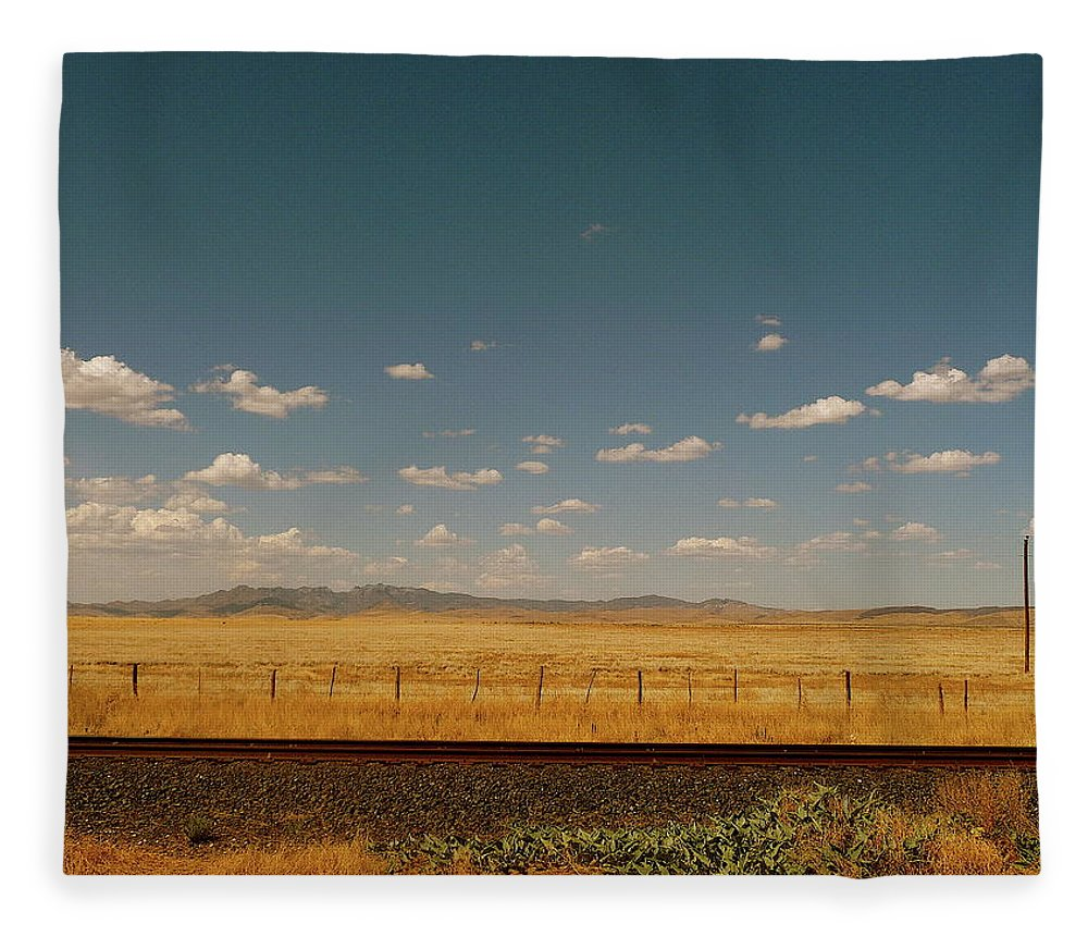 Tranquility Fleece Blanket featuring the photograph Texan Desert Landscape And Rail Tracks by Papilio
