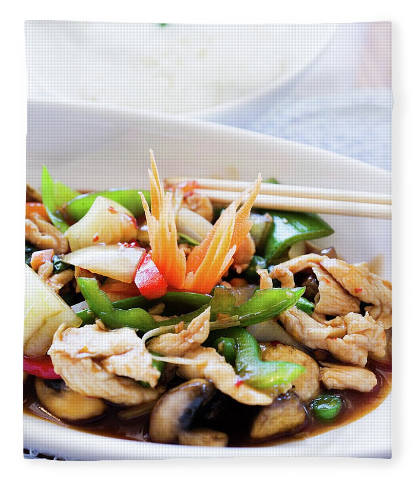 Chicken Meat Fleece Blanket featuring the photograph Thai Basil Chicken Dish And Bowl Of by Rapideye