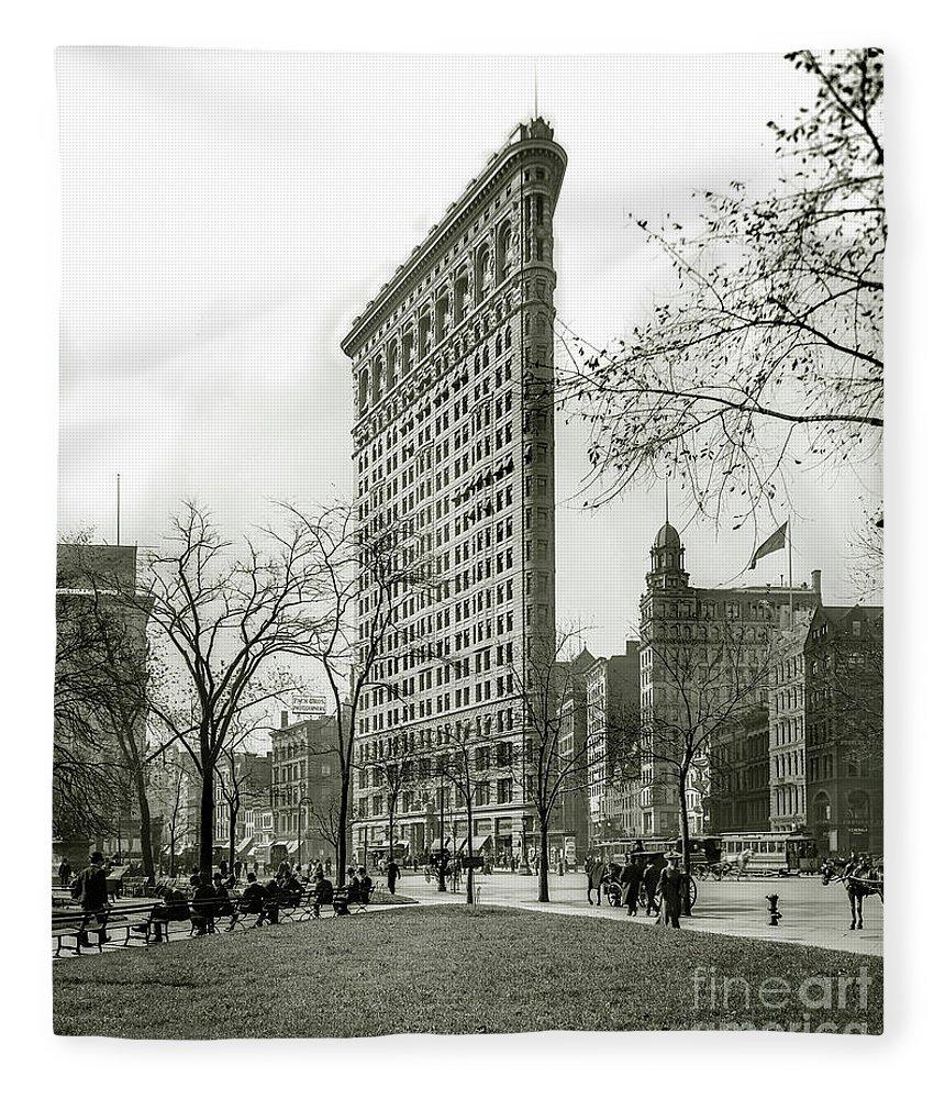 Flatiron Fleece Blanket featuring the photograph The Flatiron Building 1903 by Jon Neidert