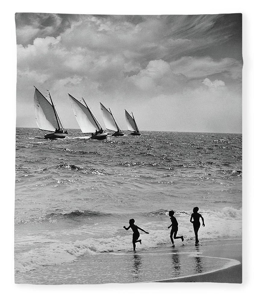 Following Fleece Blanket featuring the photograph Three Boys Running Along Beach by Stockbyte