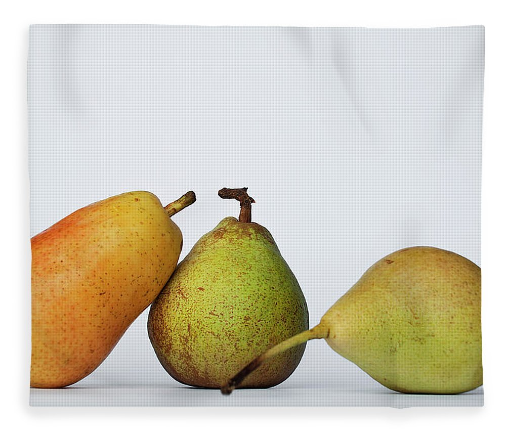 Healthy Eating Fleece Blanket featuring the photograph Three Diferent Pears Isolated On Grey by Irantzu Arbaizagoitia Photography