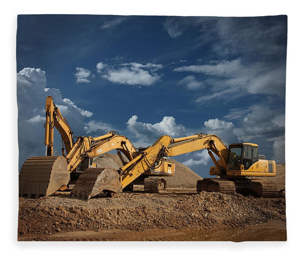 Working Fleece Blanket featuring the photograph Three Excavators At Construction Site by Narvikk