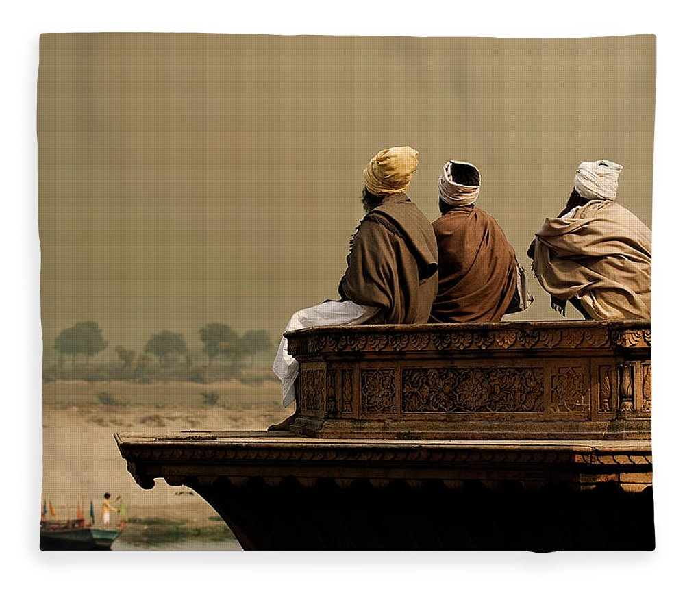 Water's Edge Fleece Blanket featuring the photograph Three Sadhus Meditating By The Yamuna by Globalstock