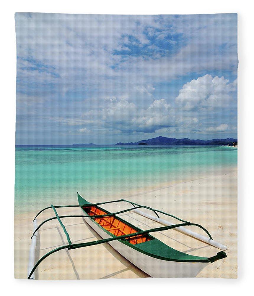 Tranquility Fleece Blanket featuring the photograph Traditional Filipino Banka Outrigger by Joyoyo Chen