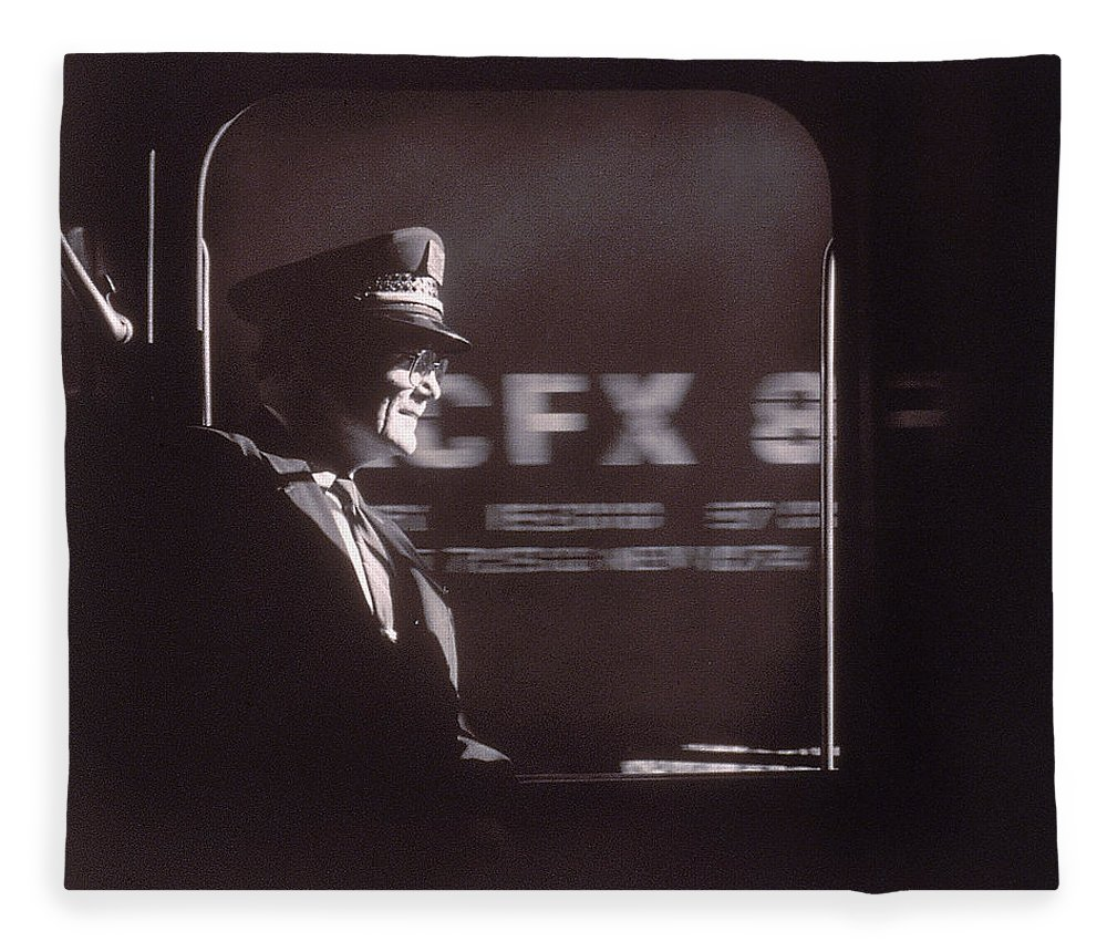 Working Fleece Blanket featuring the photograph Train Conductor Looking Out Of Window by John Coletti