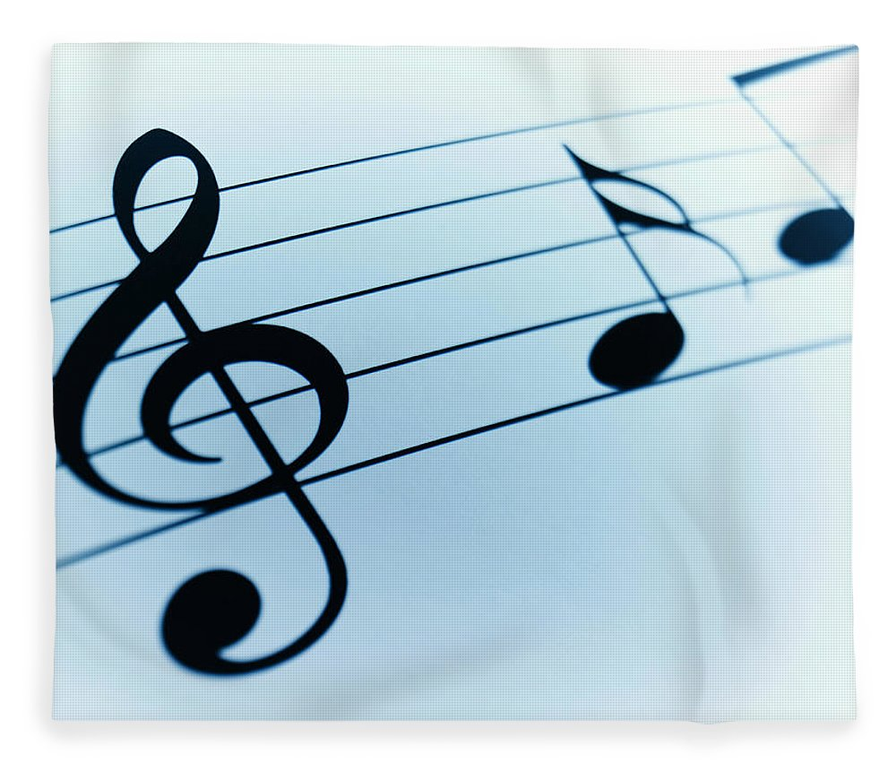 Sheet Music Fleece Blanket featuring the photograph Treble Clef And Notes by Adam Gault