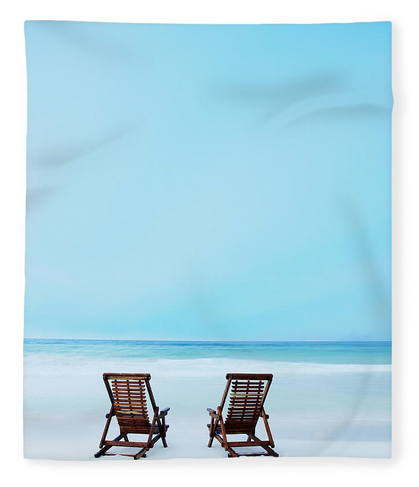 Dawn Fleece Blanket featuring the photograph Two Beach Chairs On Tropical Beach At by Thomas Barwick