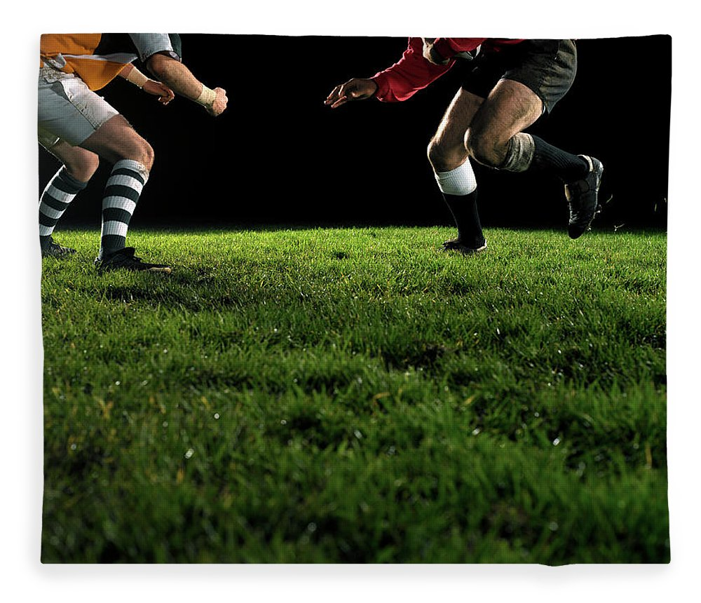 Grass Fleece Blanket featuring the photograph Two Opposing Rugby Players, One Holding by Thomas Barwick