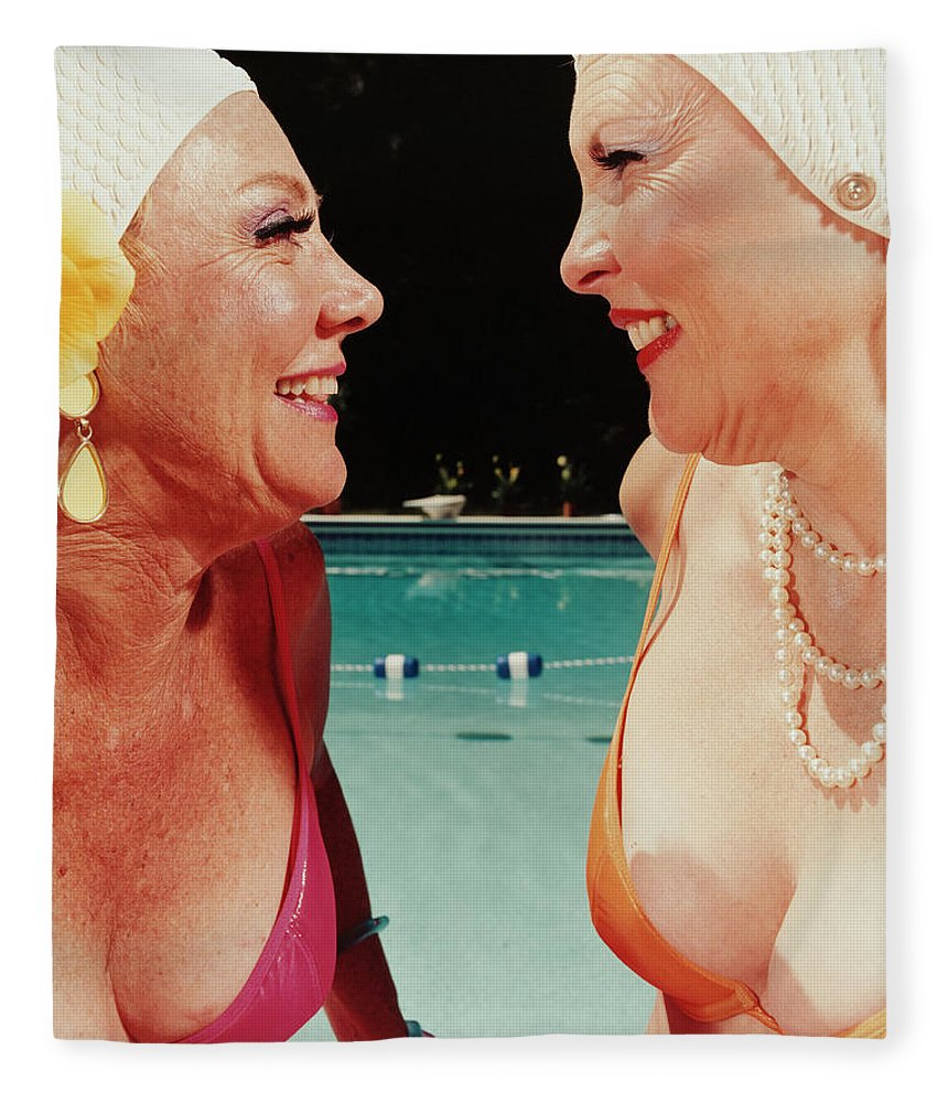 Mature Adult Fleece Blanket featuring the photograph Two Women By Pool by Silvia Otte