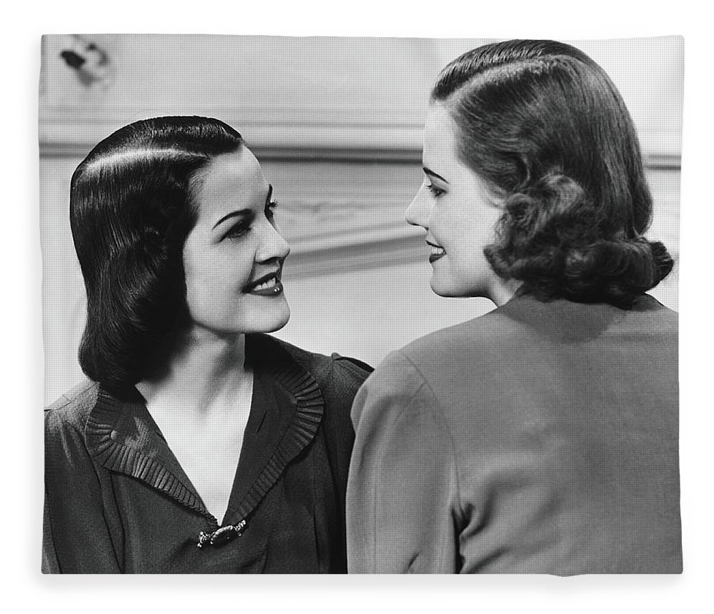 People Fleece Blanket featuring the photograph Two Women Conversing In Living Room, B&w by George Marks