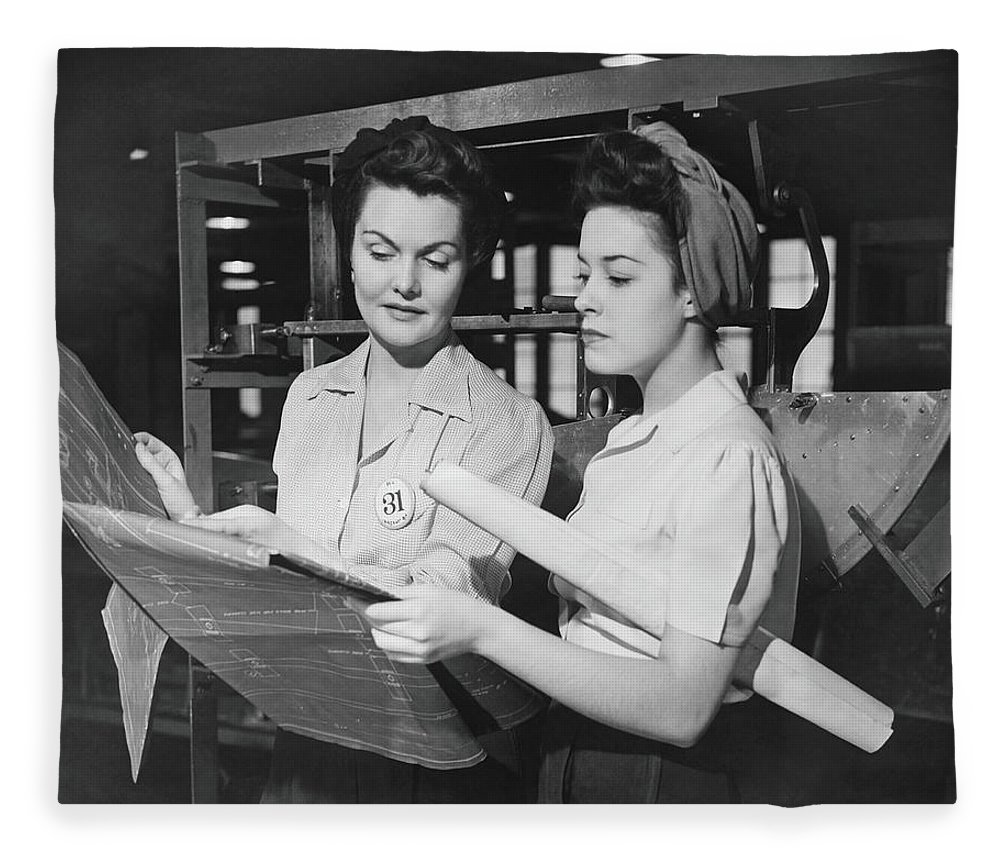 Plan Fleece Blanket featuring the photograph Two Women In Workshop Looking At by George Marks