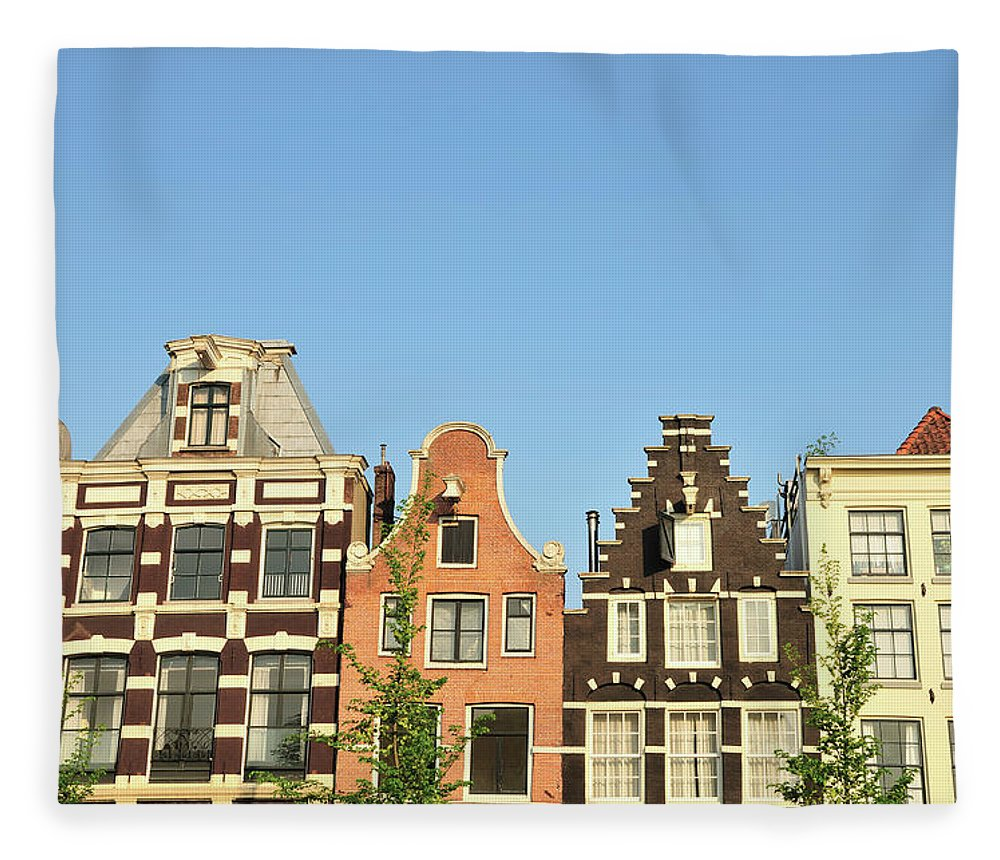In A Row Fleece Blanket featuring the photograph Typical Canal Houses, Amsterdam, The by Gorazdbertalanic