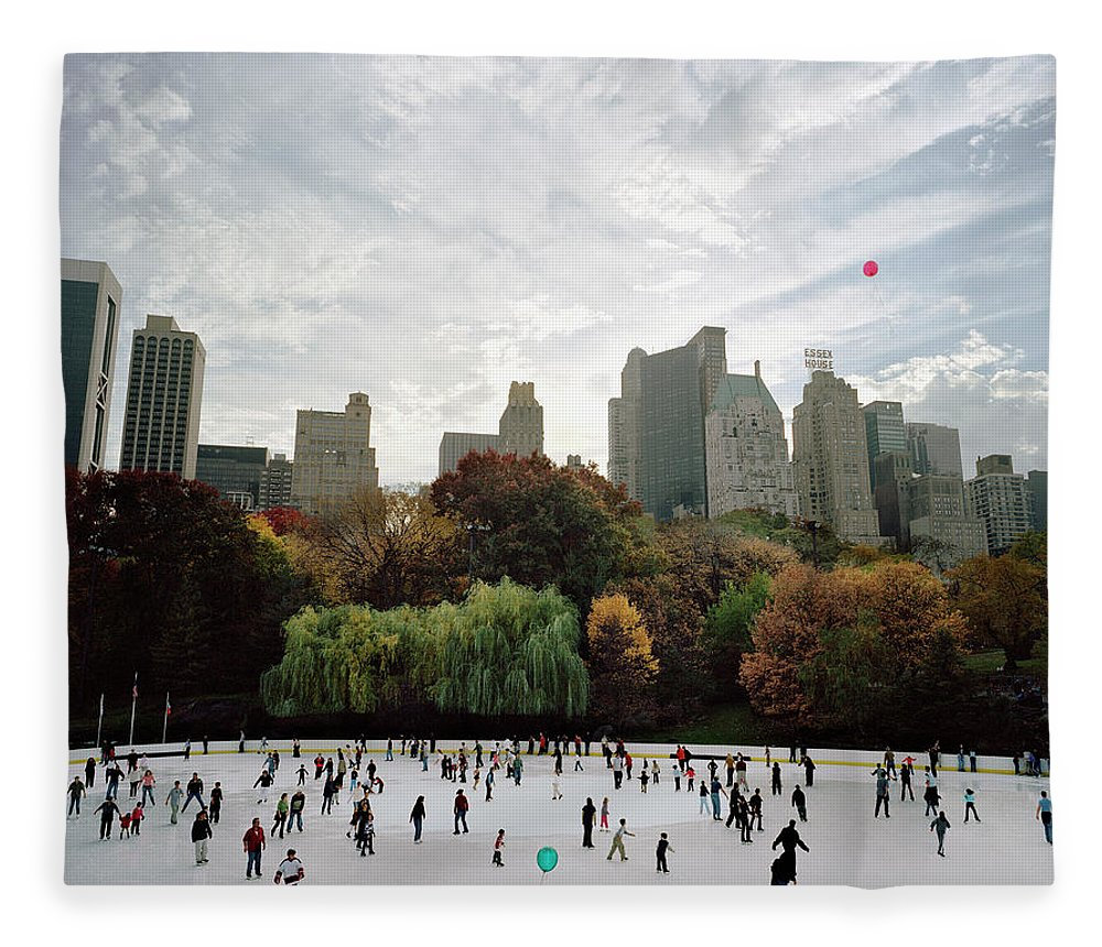 Child Fleece Blanket featuring the photograph Usa, New York City, People Ice Skating by Carl Lyttle