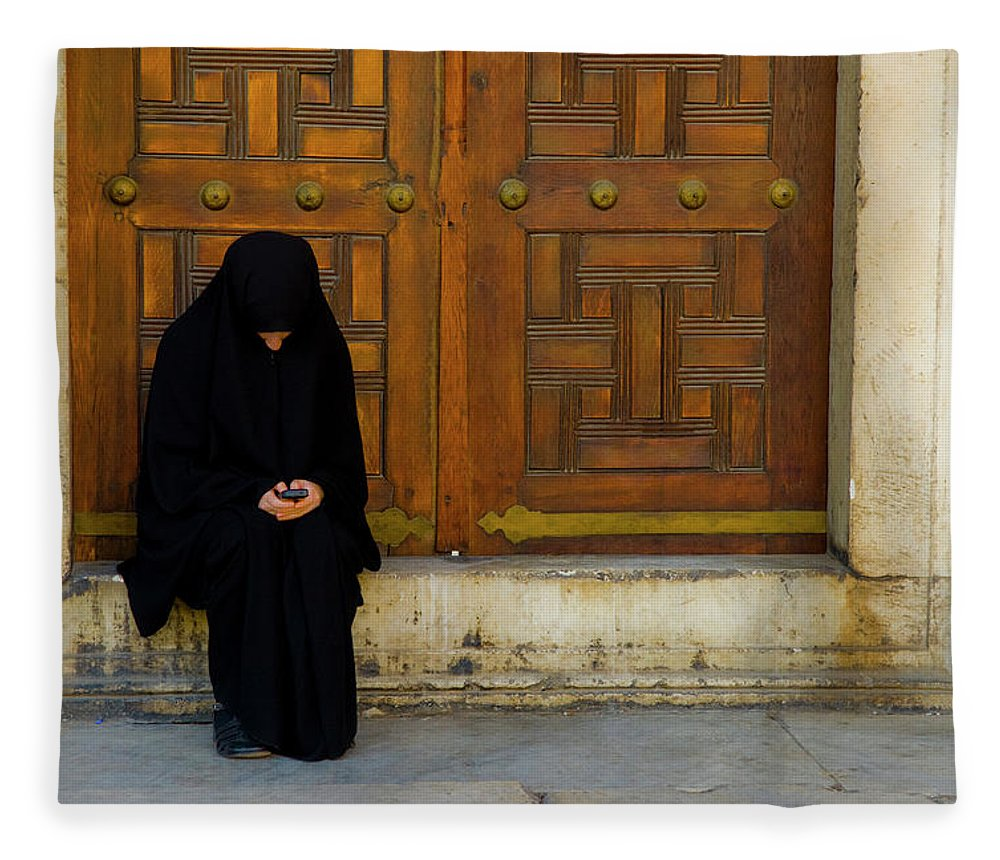 Istanbul Fleece Blanket featuring the photograph Veiled Girl Send Message On Mobile Phone by Marco Vacca