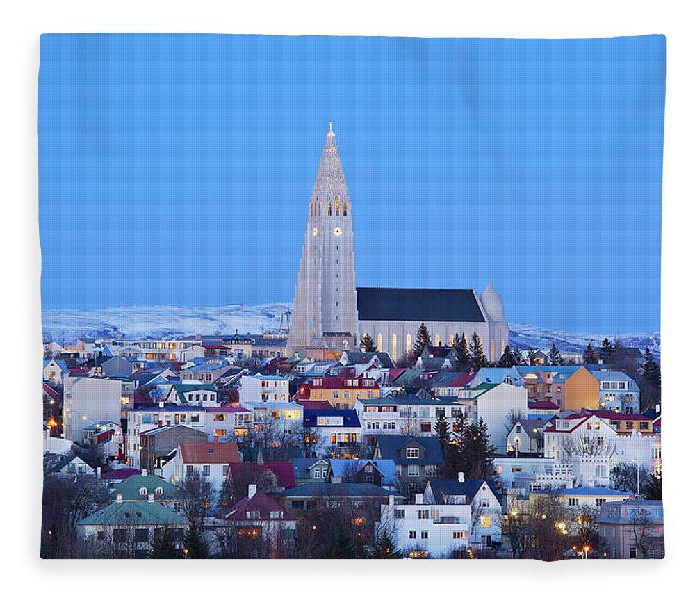 Snow Fleece Blanket featuring the photograph View Of Hallgrimskirkja Church by Travelpix Ltd