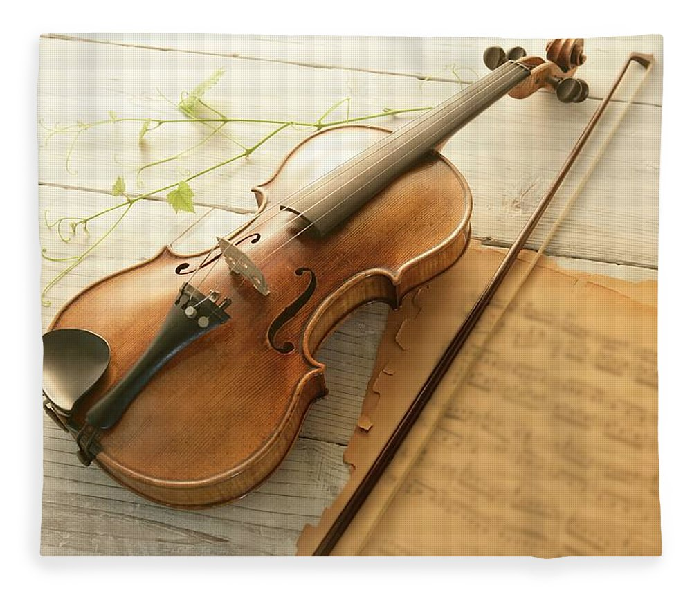 Sheet Music Fleece Blanket featuring the photograph Violin And Music Sheet by Image Work/amanaimagesrf