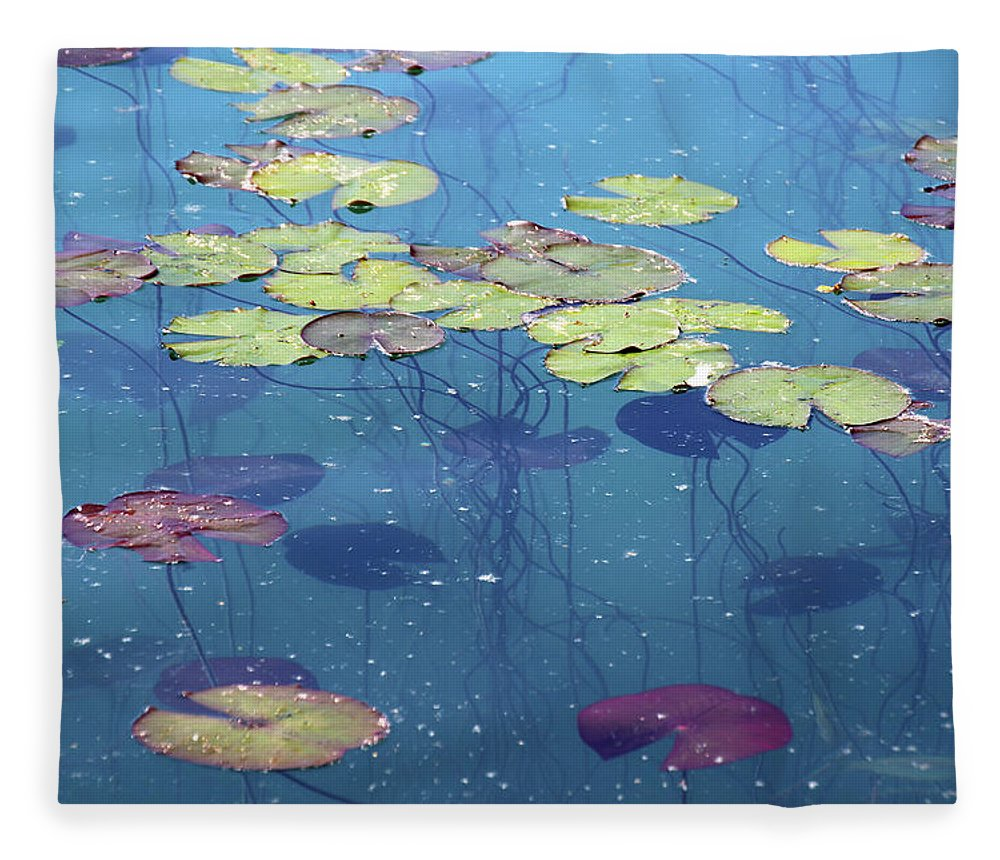 Shadow Fleece Blanket featuring the photograph Water Lillies Leaves by Suzyco