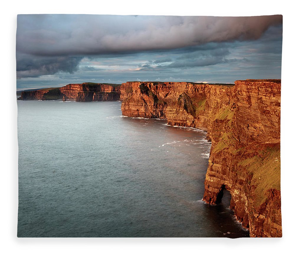 Scenics Fleece Blanket featuring the photograph Waves Washing Up On Rocky Cliffs by George Karbus Photography