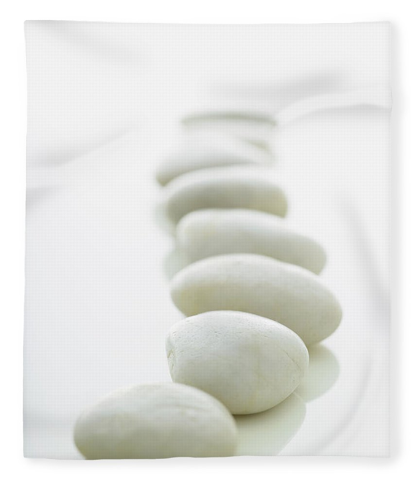 White Background Fleece Blanket featuring the photograph White Stones Lined Up On A White by Rick Lew