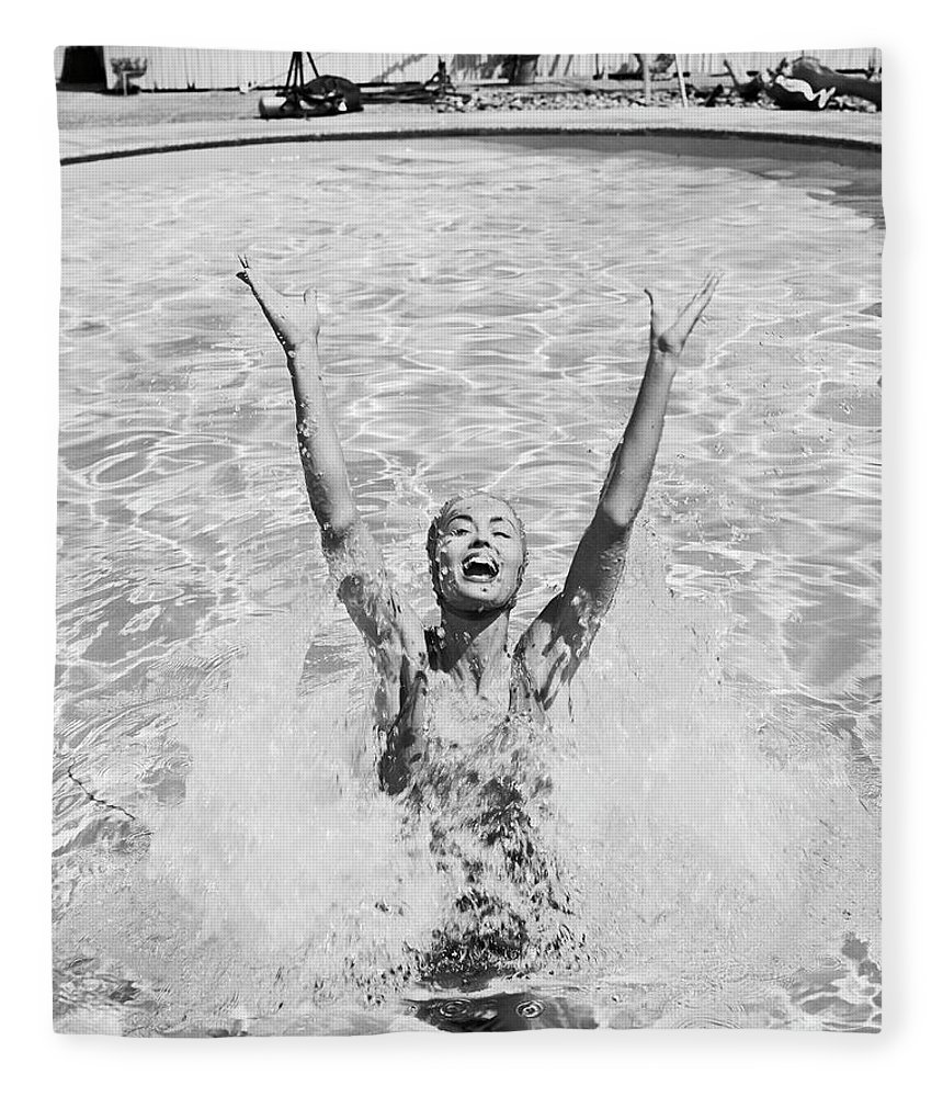 Human Arm Fleece Blanket featuring the photograph Woman Having Fun In Swimming Pool by Tom Kelley Archive