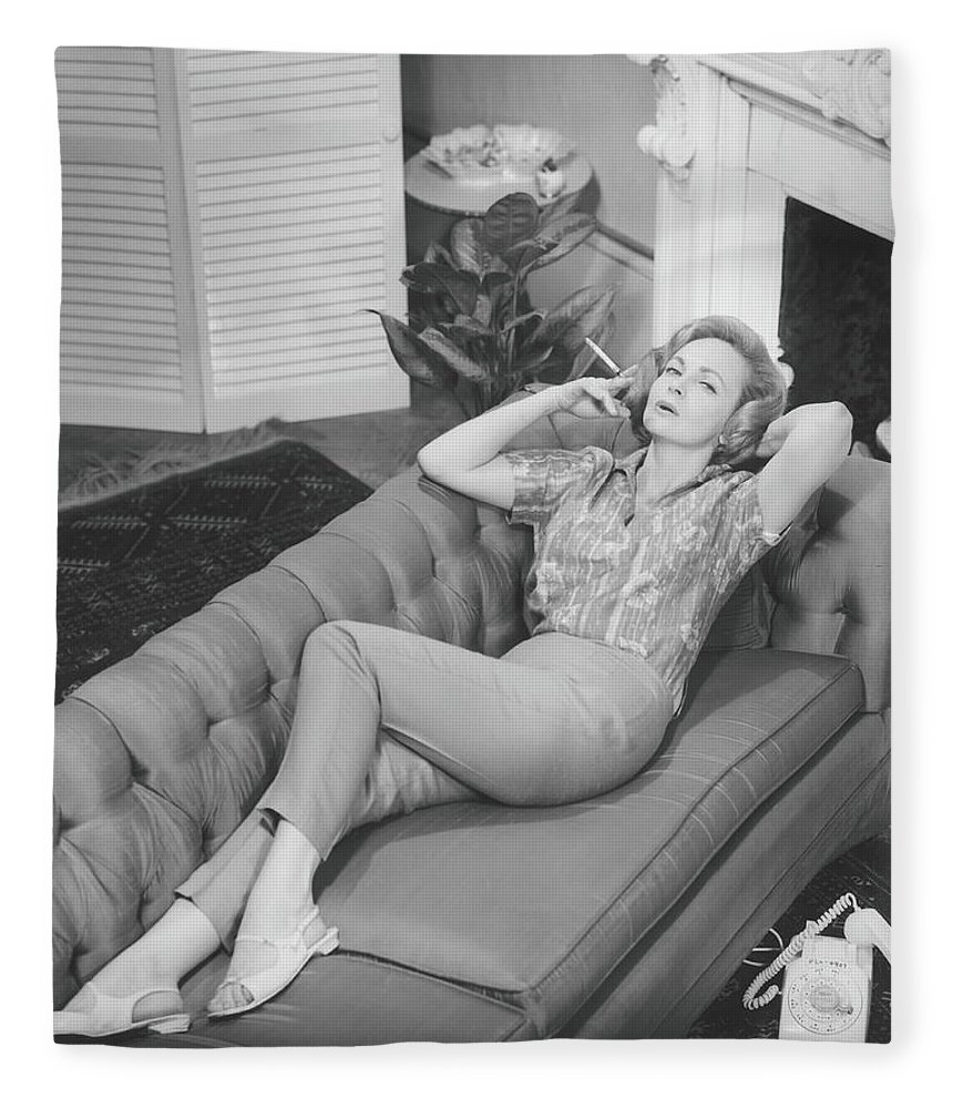 Smoking Fleece Blanket featuring the photograph Woman Relaxing On Sofa, B&w, Elevated by George Marks
