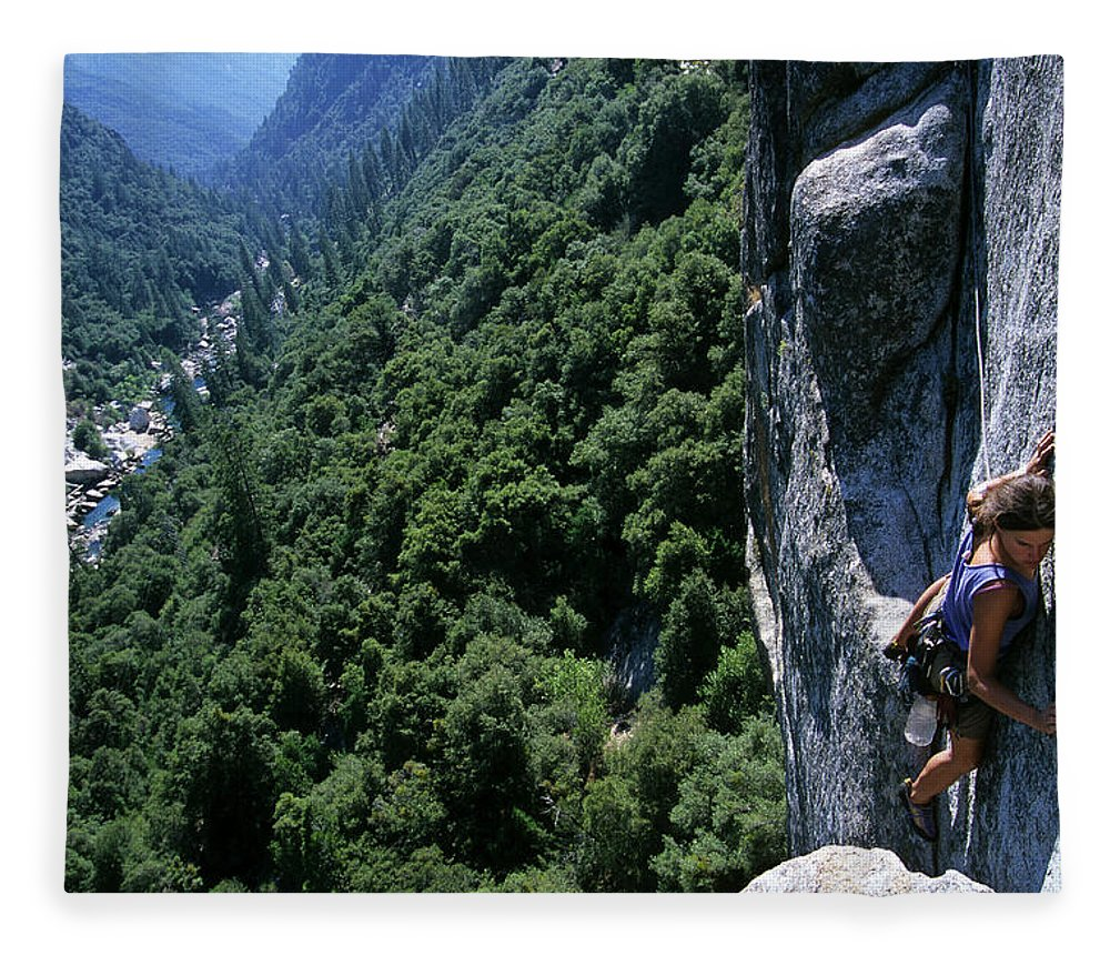 People Fleece Blanket featuring the photograph Woman Rock Climbing High Above River by Heath Korvola