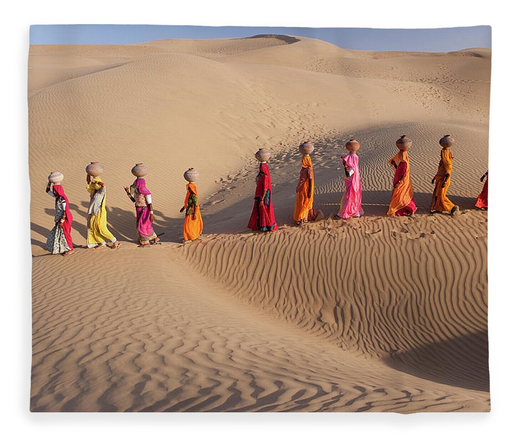 People Fleece Blanket featuring the photograph Women Fetching Water From The Sparse by Mint Images - Art Wolfe