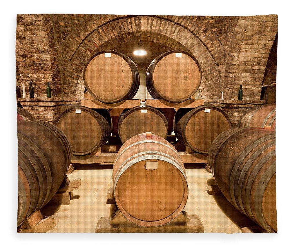 Arch Fleece Blanket featuring the photograph Wooden Barrels In Wine Cellar by Benedek