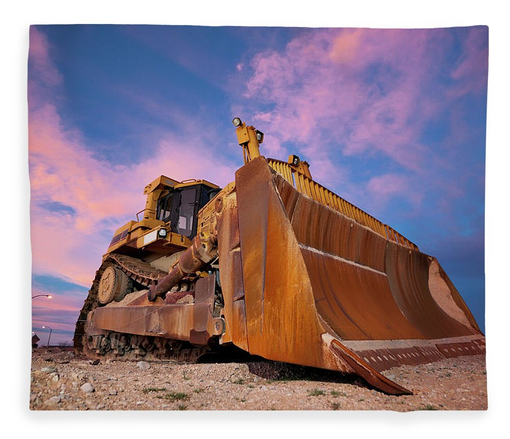 Toughness Fleece Blanket featuring the photograph Yellow Bulldozer Working At Sunset by Wesvandinter