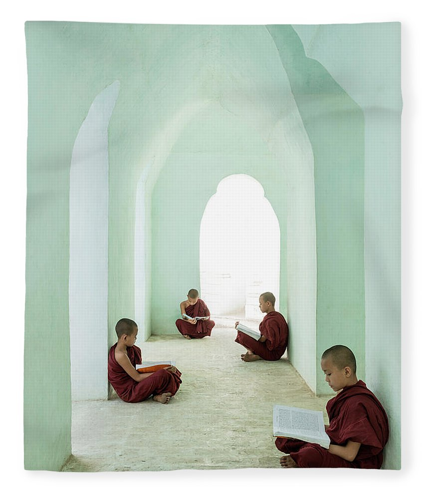 Arch Fleece Blanket featuring the photograph Young Buddhist Monks Reading In Temple by Martin Puddy