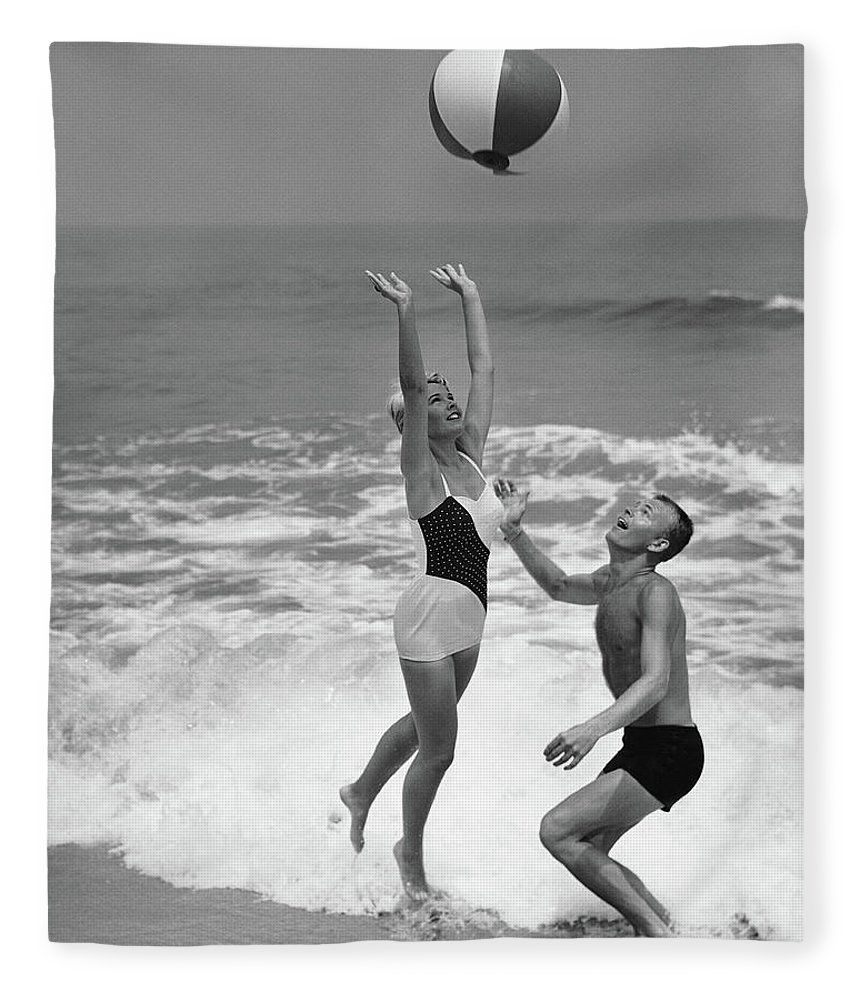Young Men Fleece Blanket featuring the photograph Young Couple Playing With Beach Ball At by Stockbyte