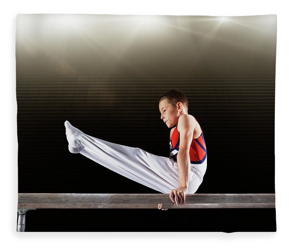 Focus Fleece Blanket featuring the photograph Young Male Gymnast Performing On by Robert Decelis Ltd
