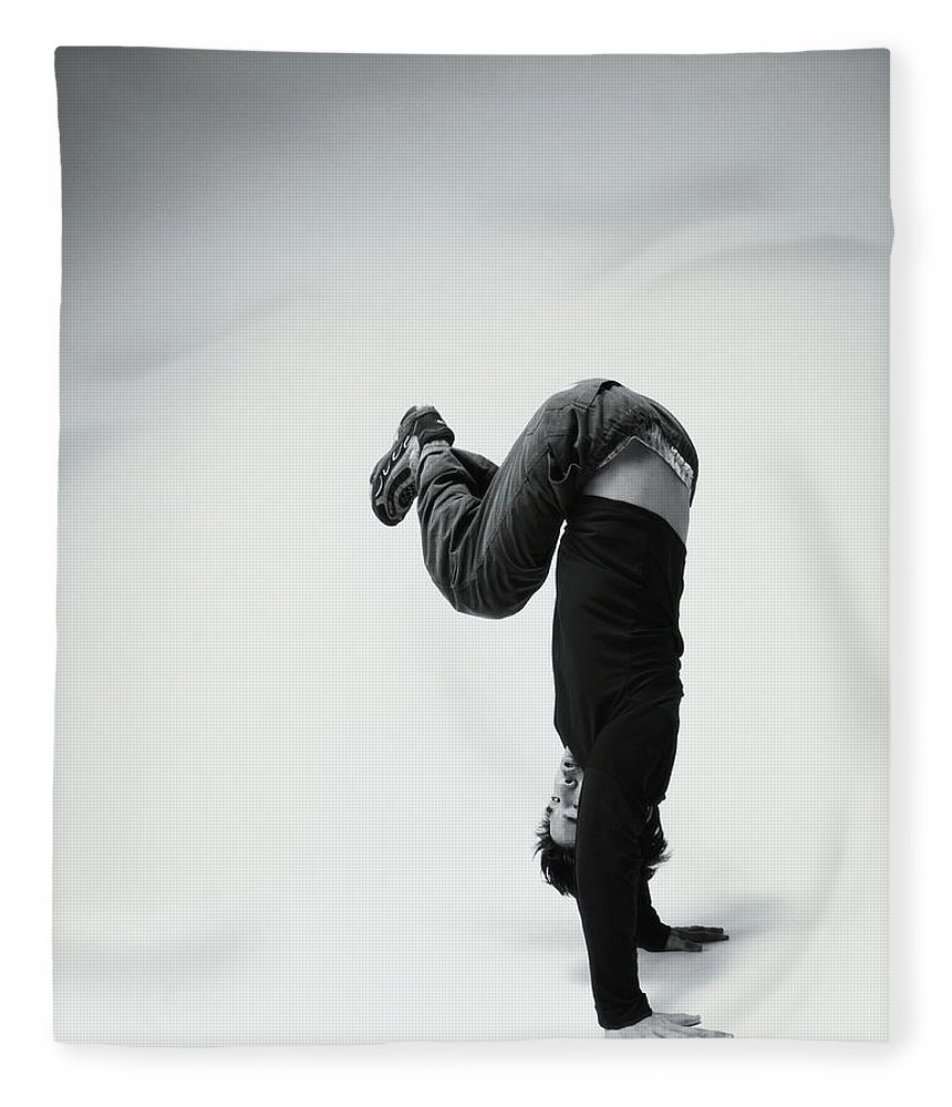 Youth Culture Fleece Blanket featuring the photograph Young Man Breakdancing B&w by Karen Moskowitz