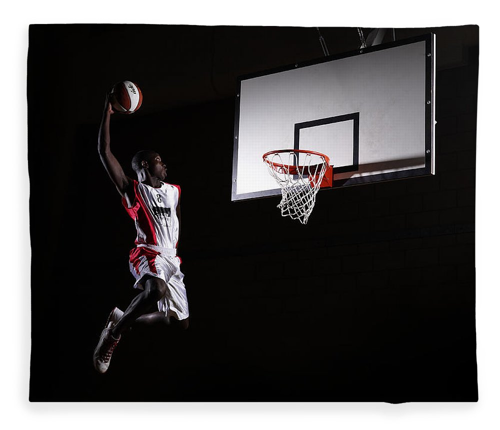 Human Arm Fleece Blanket featuring the photograph Young Man In The Air About To Dunk The by Compassionate Eye Foundation/steve Coleman/ojo Images Ltd