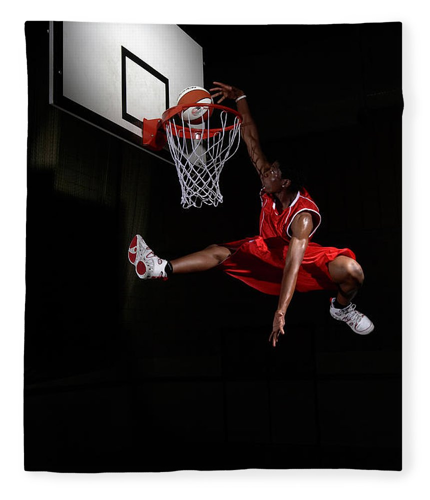 Human Arm Fleece Blanket featuring the photograph Young Man Making A Fancy Dunk by Compassionate Eye Foundation/steve Coleman/ojo Images Ltd