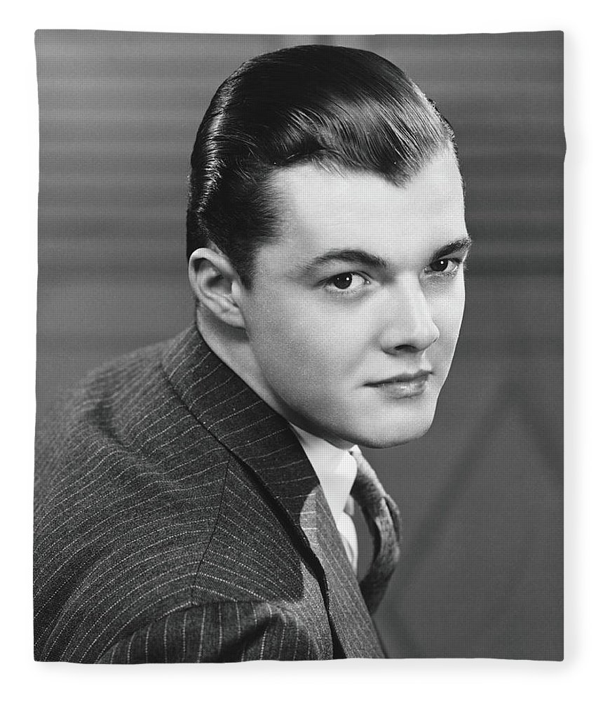 Young Men Fleece Blanket featuring the photograph Young Man Wearing Pinstripe Jacket by George Marks