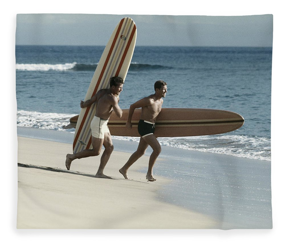 People Fleece Blanket featuring the photograph Young Men Running On Beach With by Tom Kelley Archive