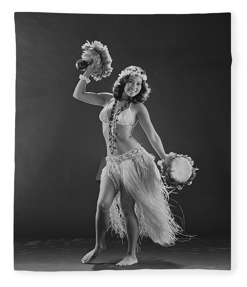 People Fleece Blanket featuring the photograph Young Woman Hula Dancer With Feathered by Tom Kelley Archive