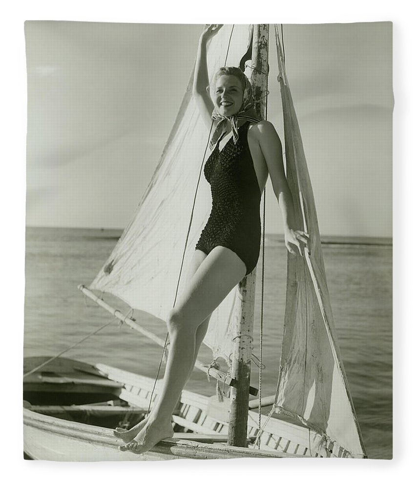 Human Arm Fleece Blanket featuring the photograph Young Woman Posing On Sailboat by George Marks