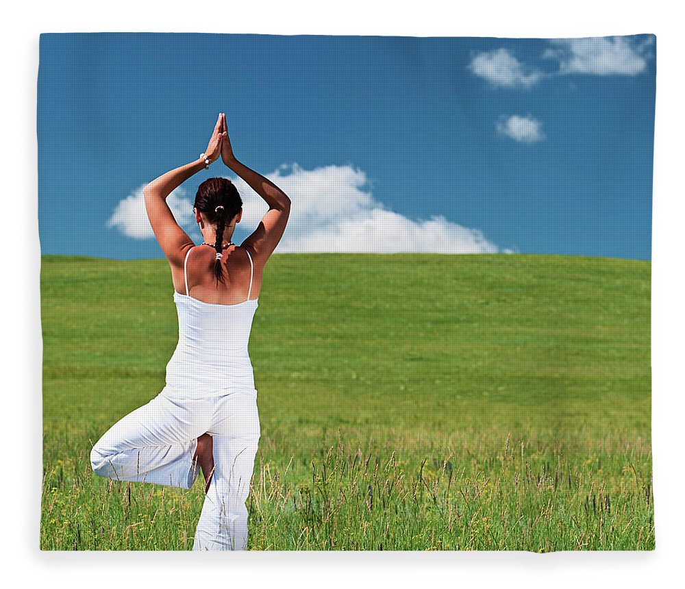 Scenics Fleece Blanket featuring the photograph Young Woman Practicing Yoga by Hadynyah