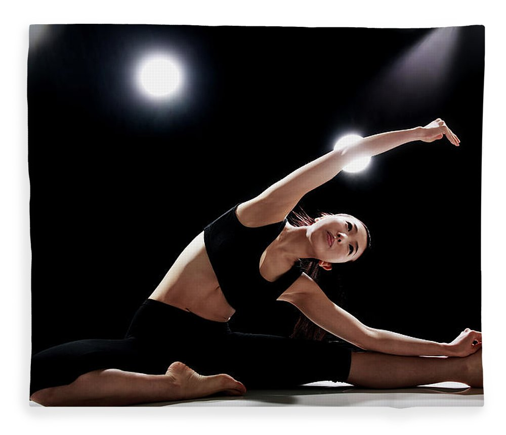 People Fleece Blanket featuring the photograph Young Woman Stretching by Runphoto