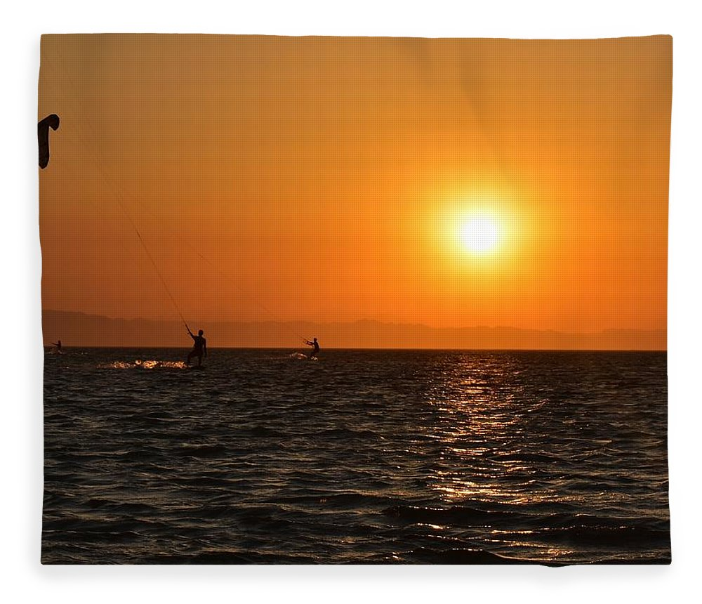 Kitesurfing Fleece Blanket featuring the photograph Red sea sunset by Luca Lautenschlaeger