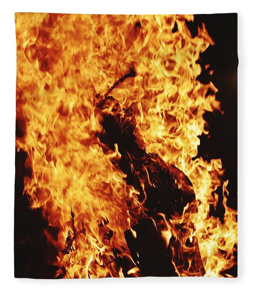 Campfire Fleece Blanket featuring the photograph Closeup of Fire at time of festival by Ravindra Kumar