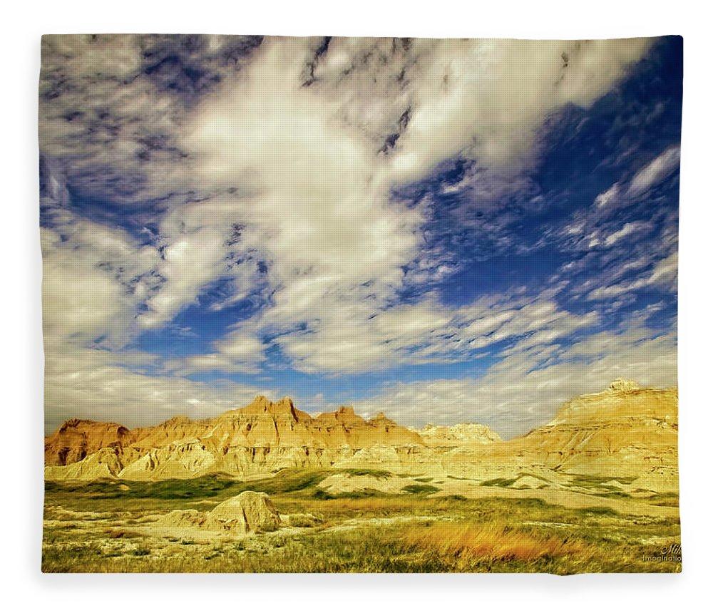 Badlands Fleece Blanket featuring the photograph Badlands Showdown by Mike Braun