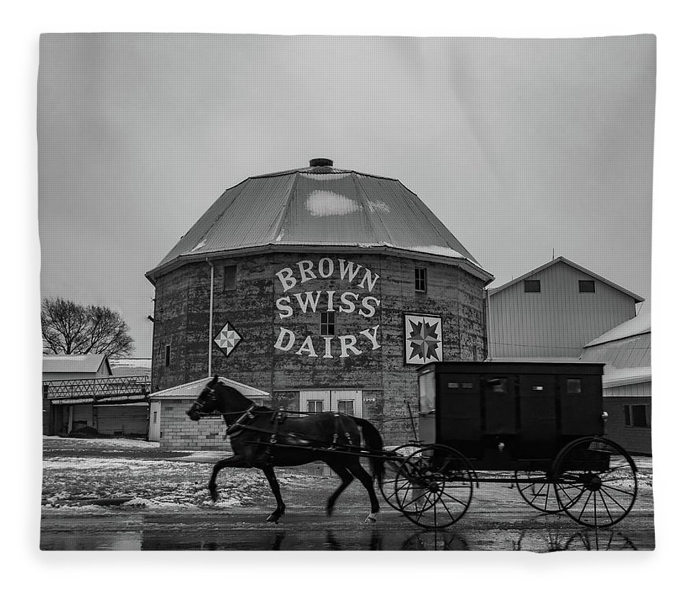Landscape Fleece Blanket featuring the photograph Brown Swiss Dairy Round Barn In Black And White by Scott Smith