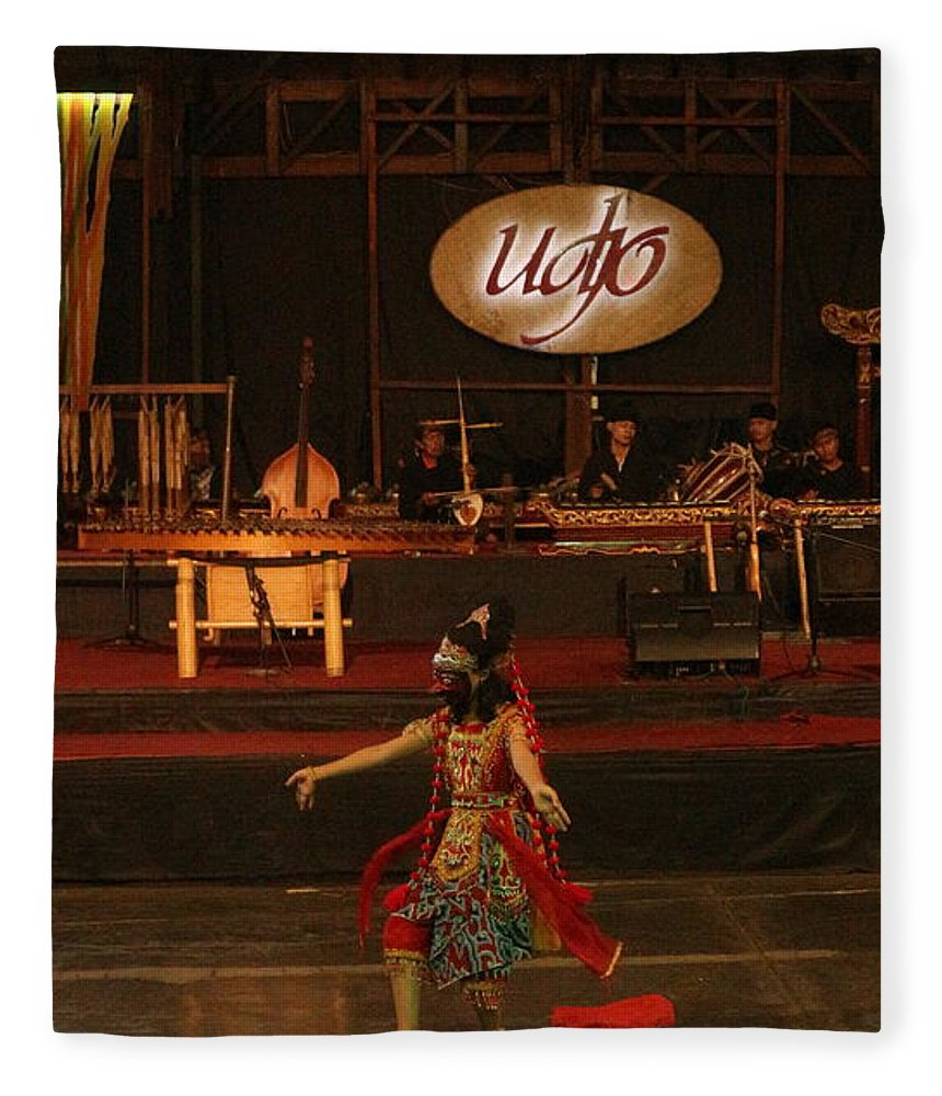 Dance Fleece Blanket featuring the photograph Mask Dance by Lingga Tiara Setiadi