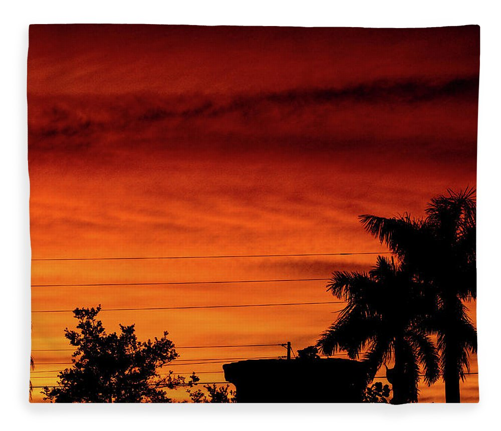 Sunset Fleece Blanket featuring the photograph The Fire sky by Daniel Cornell