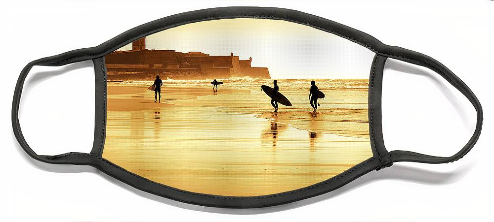 Action Face Mask featuring the photograph Surfers silhouettes by Carlos Caetano