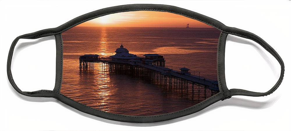 Piers Face Mask featuring the photograph Sunrise over Llandudno pier 2 by Christopher Rowlands