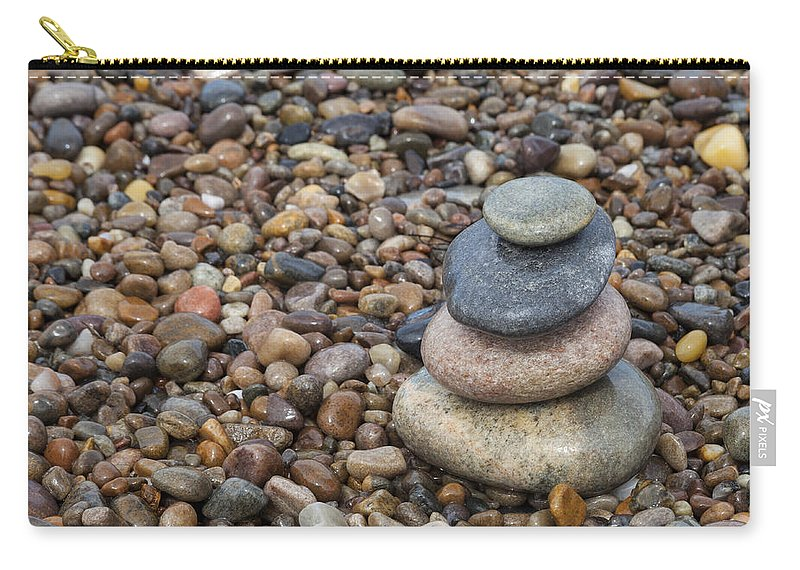 Beach Carry-all Pouch featuring the photograph Cairn On Wet Pebbles by Diane Macdonald